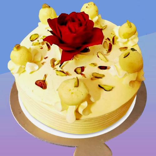 Rasmalai cake with rose on top